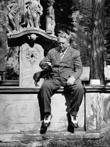 William Randolph Hearst and one of his Dachshunds