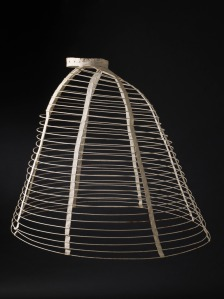 Women's Cage Crinoline, 1865. Made of cotton-braid-covered steel, cotton twill and plain-weave double-cloth tape, cane, and metal. (Image Courtesy LACMA.)
