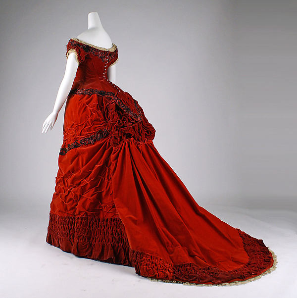 1875 Red Silk Ball Gown.(Image via Met Museum)