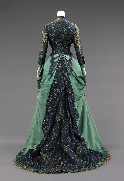 1875 House of Worth Silk Afternoon Dress.(Image via Met Museum)