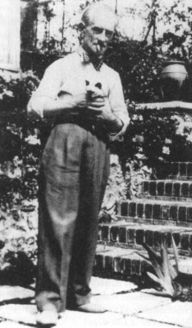 Maurice Ravel with his Siamese cat, Mouni, at Belvedere in 1929.