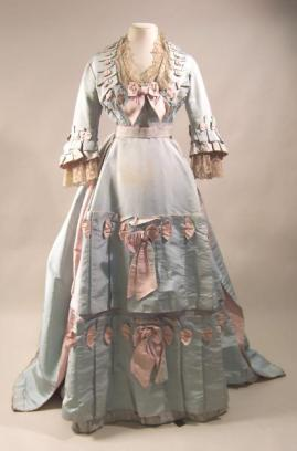 1871-1873 Pale Green Silk Dress Trimmed in Pink.(Manchester Art Gallery)